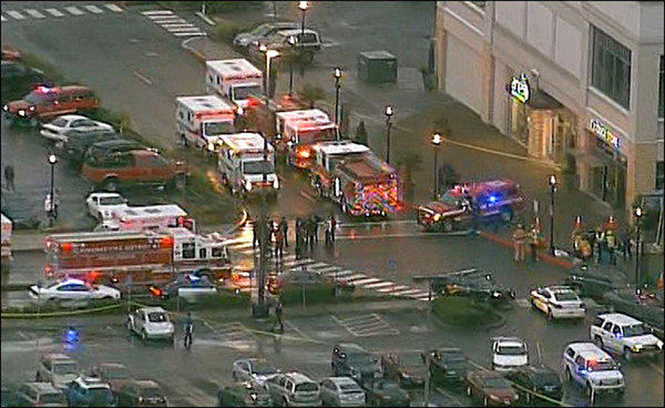 Emergency vehicles arrive after a shooting at the Clackamas Town Center mall near Portland, Ore.