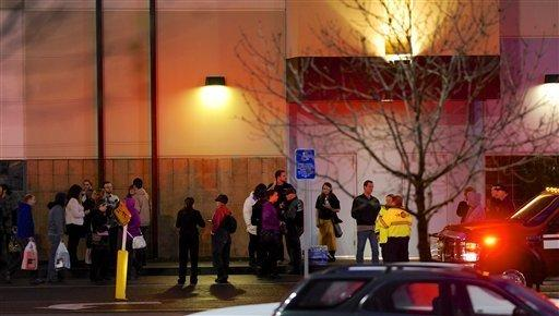People outside the suburban Portland, Ore., mall where a gunman opened fire, killing two people and wounding one. The gunman killed himself, authorities said.