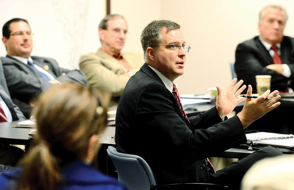 Del. Neil C. Parrott gestures while speaking with Washington County Commissioners on Tuesday.