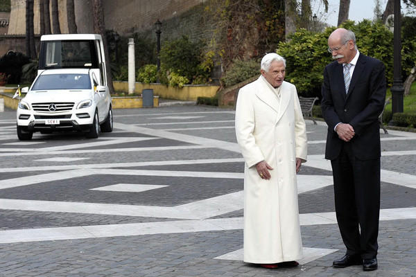 Dieter Zetsche, head of Mercedes-Benz Cars, chats with Pope Benedict XVI in front of the new Popemobile.