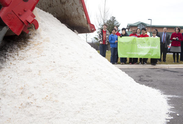 A truck dumps 9.6 tons of white sand, representing sugar, in the parking lot of Burleigh Manor Middle School in Ellicott City. The load illustrated the amount of sugar the school's students would consume if each drank one 12-ounce soda a day for a year.
