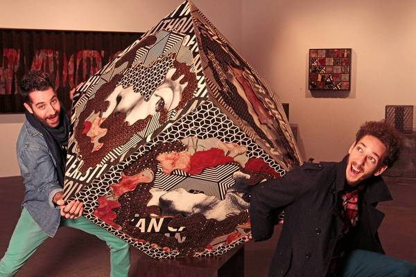 """Cyrcle members Rabi, above left, and David Leavitt play around with """"The Hive Layer Cubix"""" at their """"Organized Chaos!"""" show, an exhibition that encourages viewers to touch the artwork"""