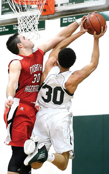 North Hagerstown's Andrew Yacyk, left, defends against South Hagerstown's K.J. White during the first half of Tuesday night's MVAL Antietam game.