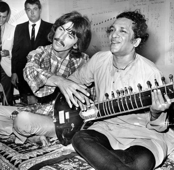 George Harrison with his musical mentor, Ravi Shankar.