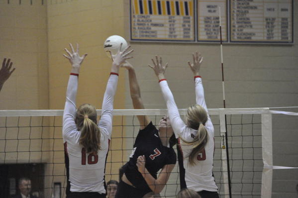 West Aurora's Lauren Carlini, No. 7, spikes against Benet Academy defenders in the Blackhawks' 25-10, 25-11 loss to Benet in the Class 4A Neuqua Valley sectional Oct. 30. She was named the Gatorade Player of the Year on Tuesday.