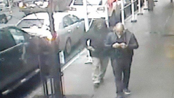 An image provided by police shows the gunman, left, just before he shot Brandon Woodard.
