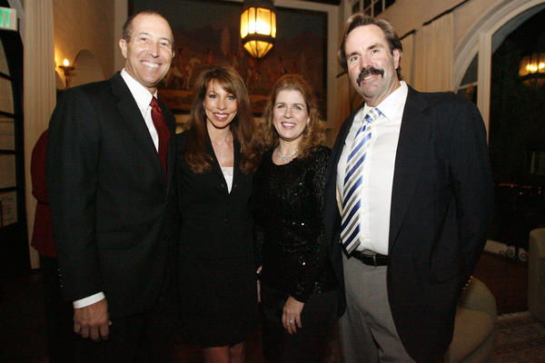 Fred Paccone, from left, Linda Taix-Paccone, Brenda Gant and Jeff Hughes attend the 100th annual meeting and holiday reception, which took place at FSHA in La Canada on Tuesday, December 11, 2012.