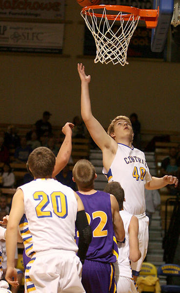 Tyler Block (40) of Aberdeen Central goes up for a rebound Tuesday in Aberdeen.