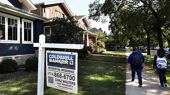 A sign stands outside a house for sale in the 4400 block of North Mozart Avenue in Chicago.