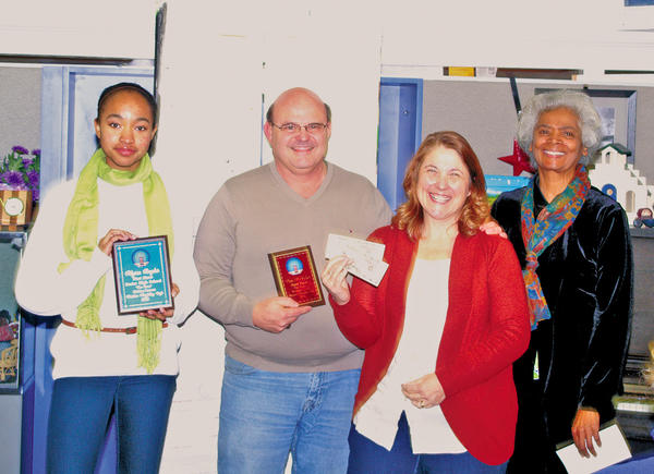 From left, Alyssa Royster, first-prize winner in the senior high division; Steve McCullum, third-prize winner in the adult division; Patricia McCullum, first-prize winner in the writing contest; and Faith Crumbly, executive director of the Christian Storytelling Caf.