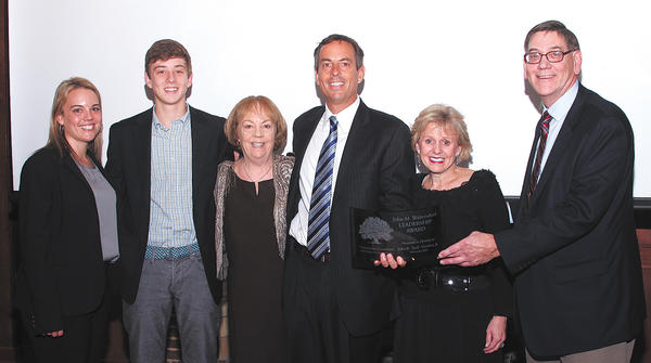 "The family of the late John R. ""Jack"" Hershey Jr. recently accepted the John M. Waltersdorf Leadership Award from the Community Foundation of Washington County. From left, Laura Spessard and Holden Hershey, grandchildren; and children Karen Spessard, John R. Hershey III and Lynne Hershey Rieden; and Brad Sell, Community Foundation executive director. Missing from photo is a daughter, Cheryl Hershey."