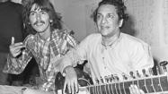"<span style=""font-size: small;"">Indian sitar player Ravi Shankar, whose influence on George Harrison helped shape the sound of some the Beatles' most experimental songs, including ""Norwegian Wood,"" died in a hospital near his home in Southern California. He was 92. In 1965, Harrison began studying the sitar with Shankar and the two quickly became friends. In 1971, Shankar performed at Harrison's Concert for Bangladesh at Madison Square Garden in New York, and later was featured on all of side one of The Concert for Bangladesht hree-LP set. The Rolling Stones, the Animals and the Byrds were among the many other rock bands that incorporated the sitar into their sound as a result of Shankar's introduction of the Indian instrument to Western musicians.</span>"