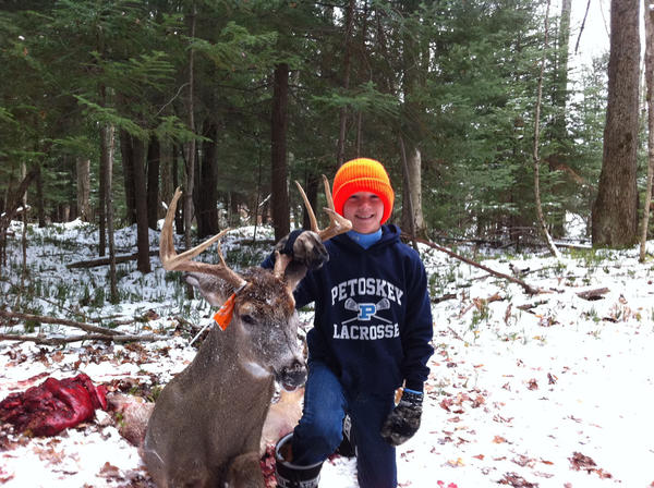 Forest Walker, 11, of Petoskey, poses with his first buck ever. Forest got his buck on his family's property in Charlevoix County.