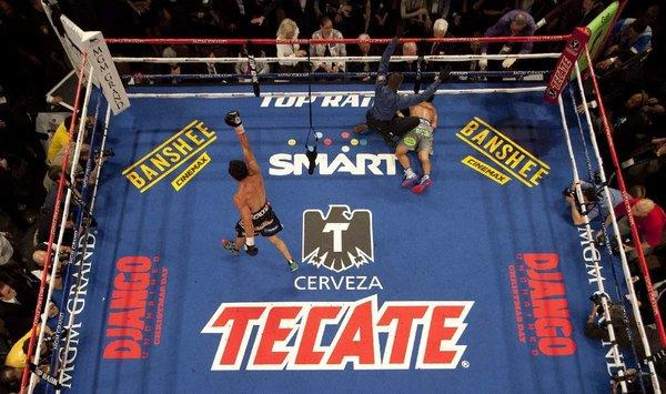 Juan Manuel Marquez, left, begins to celebrate as referee Kenny Bayless calls Manny Pacquiao down for the count in the sixth round.