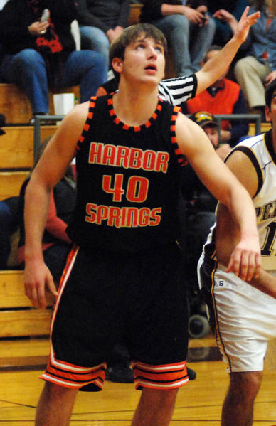 Harbor Springs senior forward Spencer Kloss had a team-high 31 points and 20 rebounds Tuesday at the Rams dropped a 97-87 decision to Cedarville in a non-league contest.