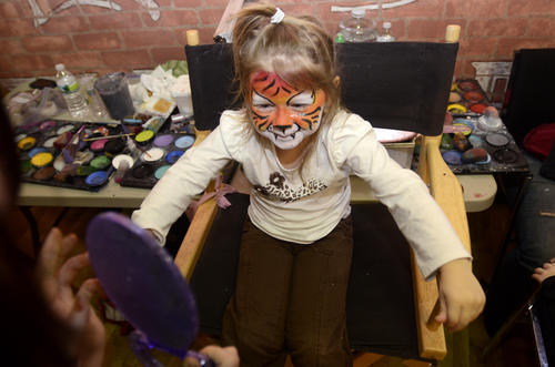 Julia Matulis, 5, of Middletown has her face painted in Main Street Market in Middletown as part of Middnight on Main.
