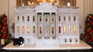 "This year's gingerbread White House features the first lady's <a href=""http://www.whitehouse.gov/about/tours_and_events/garden"">kitchen garden</a> -- fitting, since the 1,500-square-foot vegetable garden on the South Lawn of the White House is the first to be planted there since Eleanor Roosevelt's victory garden."