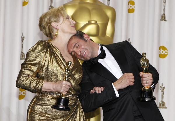 "Meryl Streep, Best Actress winner for ""The Iron Lady,"" and French actor Jean Dujardin, Best Actor winner for ""The Artist,"" pose backstage at the 84th Academy Awards in Hollywood, California, February 26, 2012"