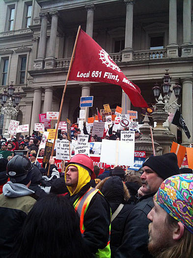 Protesters flood the Capitol in Lansing to oppose Michigan becoming the 24th right-to-work state.