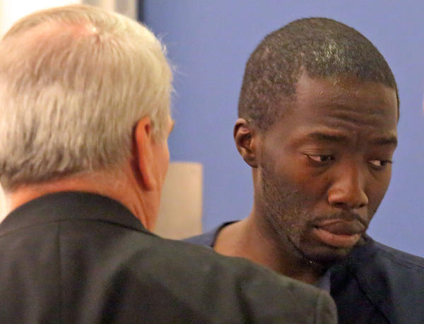 Judge orders third suspect,Nesley Ciceron,29,right,in Ocoee witness murder held without bond.