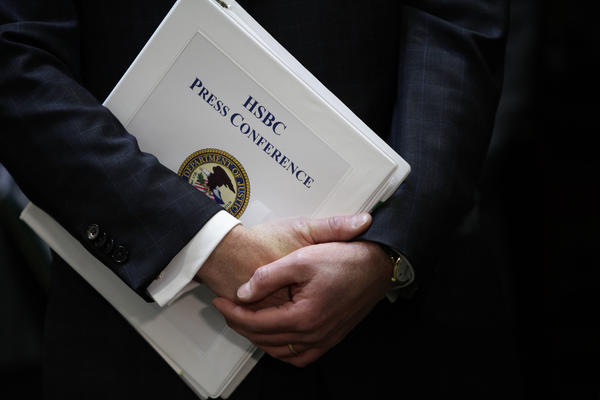 Assistant U.S. Attorney General n Lanny A. Breuer holds a binder during a news conference about HSBC. HSBC Holdings Plc agreed to pay a record $1.92 billion in fines to U.S. authorities for allowing itself to be used to launder a river of drug money flowing out of Mexico and other banking lapses.
