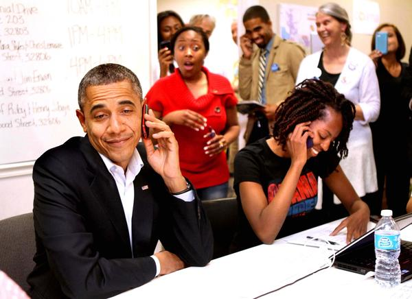 Volunteers react as President Barack Obama is connected to a wrong number while calling to thank campaign volunteers, at the Obama For America Orlando field office, in Orlando, Fla. Sunday night, October 28, 2012