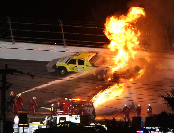 A fireball erupts from a track dryer truck after it was struck by driver Juan Pablo Montoya during a caution in the Daytona 500 at Daytona International Speedway, Monday night, Feb. 27, 2012.