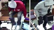 A lone robber stole money from a Mundelein bank Wednesday, and the FBI also is looking for two men who robbed a bank in Wheaton yesterday.