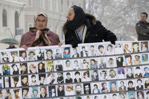 Survivors of the 1995 Srebrenica massacre hold photographs of male relatives who were killed in Europe's worst atrocity since World War II. The women staged their demonstration against Bosnian Serb commander Zdravko Tolimir in the northern Bosnian town of Tuzla on Tuesday, a day before the Yugoslav war crimes tribunal convicted him of genocide.