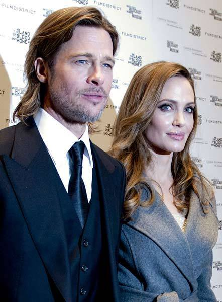 "Brad Pitt and Angelina Jolie attend the ""In the Land of Blood and Honey"" premiere at the United States Holocaust Memorial Museum."