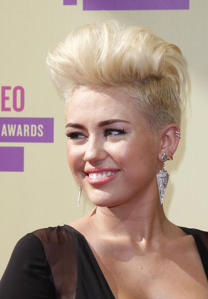 Year in Review: Entertainment news of 2012: Miley Cyrus got a drastic haircut and dye job in August, posting all the developments to Twitter saying, Never felt more me in my whole life.