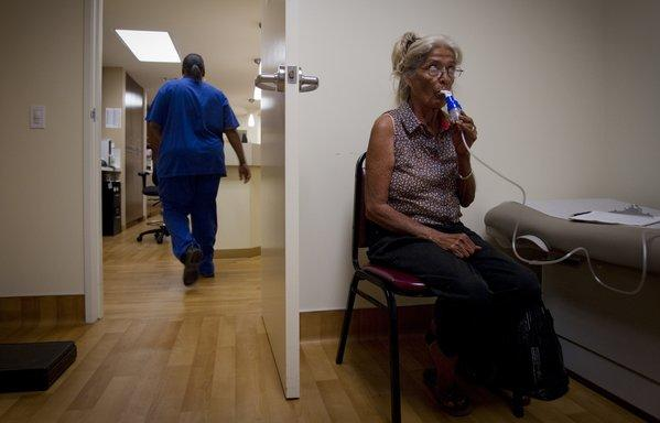 Patient Margaret Palomares uses a breathing machine after being diagnosed with asthma at T.H.E. Clinic in South Los Angeles in August. As a 64-year-old, Palomares will become eligible for Medicare within a year. But policymakers are considering whether to raise the minimum age to 67.