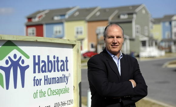 Mike Posko, CEO of Habitat for Humanity of the Chesapeake, stands on the site of a Habitat for Humanity development which will be built in the Orchard Ridge community in northeast Baltimore.