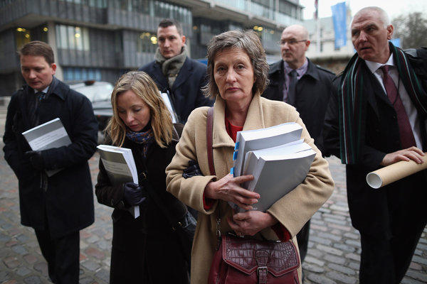 Geraldine Finucane, center, and other members of the Finucane family arrive at Methodist Central Hall to make a statement Wednesday in London.