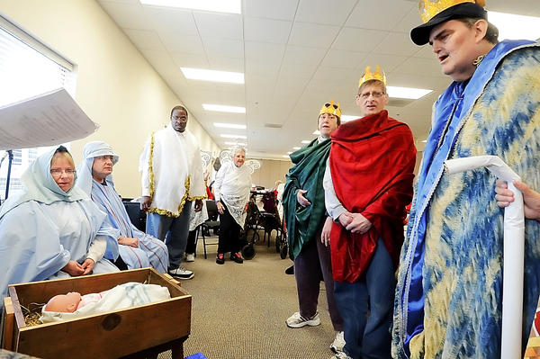 Easter Seals participants act out the Nativity story for members of Good Shepherd Ministries on Longmeadow Road after they were served lunch by the church on Wednesday.