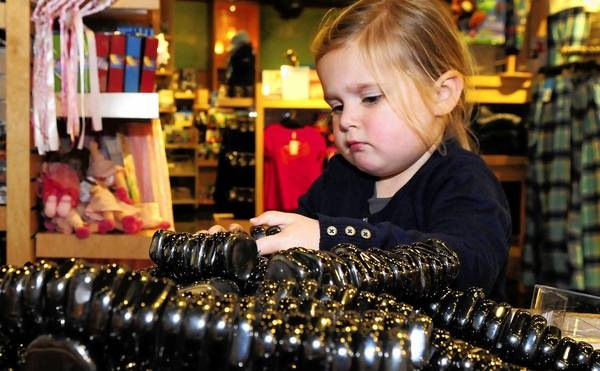 Lucy Lippert, 3, plays with magnetic stones at the Museum of Science and Industry's gift shop.