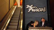 Four days before opening night, Del Frisco's Double Eagle Steakhouse is buzzing with the energy of hundreds of workers. Tables are topped with white linen and set with wineglasses, even though they'll all be refreshed before the doors open for real. One woman is walking through the dining room with a pitcher of water, presumably rehearsing her route before the customers arrive.