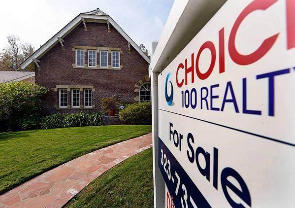 Southern California's housing market surged again in November, with the number of homes sold climbing more than 14% from a year earlier. Above, a home for sale in Los Angeles.