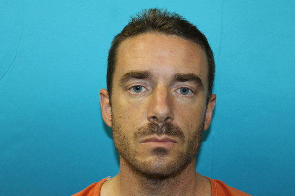 Brent Troy Bartel is accused of carving a pentagram into his 6-year-old son's back.