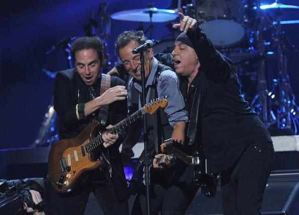 Nils Lofgren, Bruce Springsteen and Steven Van Zandt, from left, perform to benefit the Robin Hood Relief Fund to aid the victims of Superstorm Sandy.
