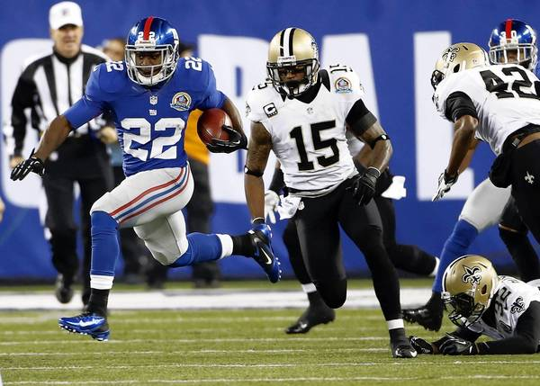 New York Giants running back David Wilson (22) returns a kick against the New Orleans Saints during the game at Metlife Stadium on December 9, 2012.