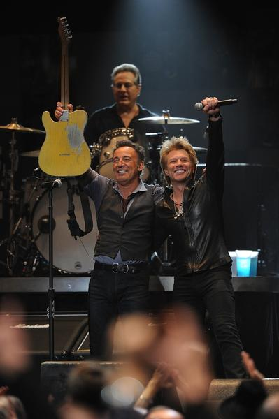 Jon Bon Jovi, right, joins Bruce Springsteen on stage at the 12-12-12 relief concert.