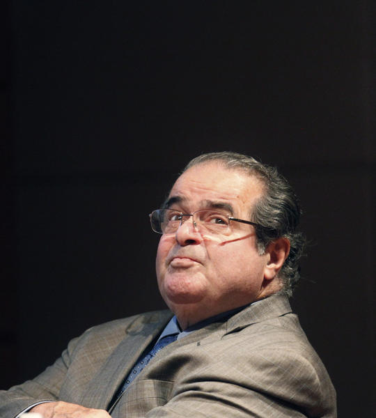 Supreme Court justice Antonin Scalia is seen before addressing the Chicago-Kent College Law justice in Chicago in 2011. On Monday, Scalia defended his legal writings that some find offensive and anti-gay.