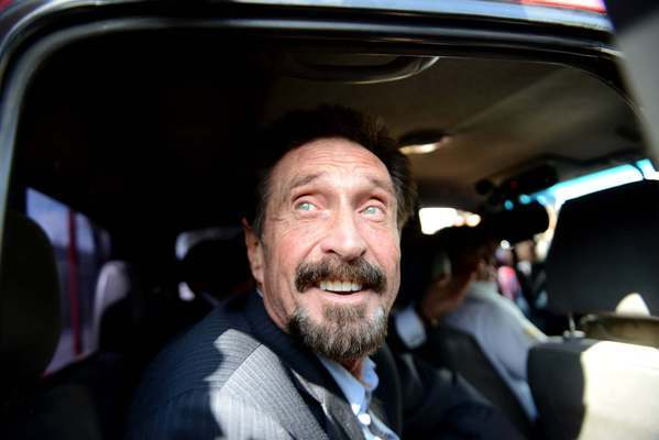 Anti-virus software pioneer John McAfee arrives at La Aurora International Airport in Guatemala City on Wednesday. McAfee avoided deportation to Belize when Guatemala decided to expel the American back to the United States instead.