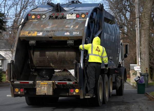 Garbage haulers collect trash in Bethlehem on Wednesday December 11, 2012.