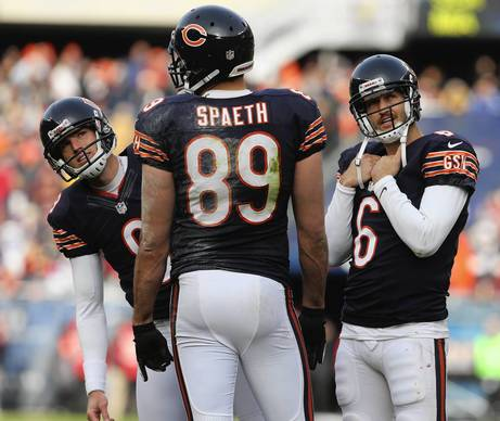 Robbie Gould and Jay Cutler watch the video board as the touchdown by tight end Matt Spaeth is being reviewed during the first half against the Vikings.