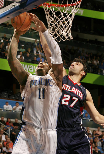 Atlanta center Zaza Pachulia (27) blocks the shot of Orlando forward Glen Davis (11) during the Atlanta Hawks at Orlando Magic NBA game at the Amway Center on Wednesday, December 12, 2012. Atlanta won the game 86-80.
