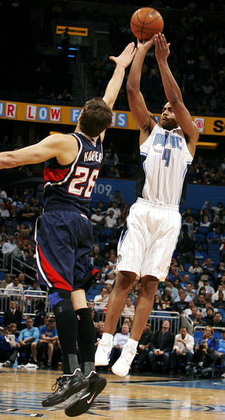 Orlando forward Arron Afflalo (4) shoots over Atlanta guard Kyle Korver (26) during the Atlanta Hawks at Orlando Magic NBA game at the Amway Center on Wednesday, December 12, 2012. Atlanta won the game 86-80.