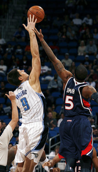 Orlando center Nikola Vucevic (9) and Atlanta forward Josh Smith (5) tip off during the Atlanta Hawks at Orlando Magic NBA game at the Amway Center on Wednesday, December 12, 2012.