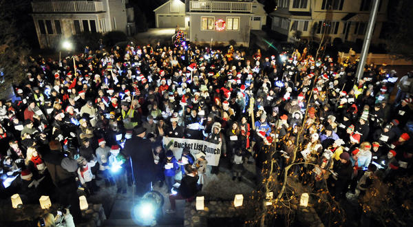 The Compo Beach grounds were packed with 600 people who registered to try and sing their way into the Guinness Book of World Records Wednesday night. The category they hope to top is the largest number of Christmas carolers going door-to-door. The group sang in front of 14 homes, for five minutes each, throughout the Compo Beach neighborhood. In photo, the massive group sang in front of a home on Fairfield Ave. led by Erik Paul, a music teacher form Weston High School. Other than the record, the group will be raising awareness and money for the Lily Sarah Grace Fund, a nonprofit started in memory of the three sisters who died in a Stamford house fire last Christmas morning.